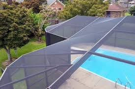 this pool enclosure follows the rounded shapes of swimming in a fluid and well screen e67