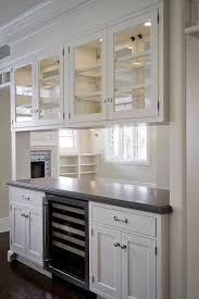 Cameo Homes: Custom pass through wall dividing living room and kitchen.  Overhead cabinets with
