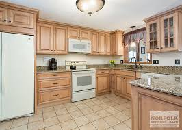 showplace maple open kitchen with white appliances maple cabinets