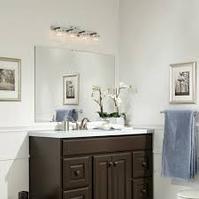 transitional bathroom with light walls wainscotting white countertop dark wood vanity and brushed