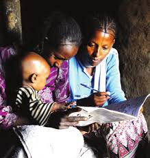 Image result for Ethiopian woman sits for an exam 30 minutes after giving birth to her son