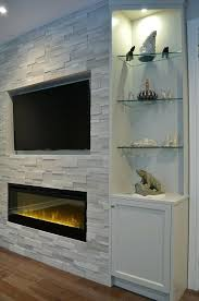 electric fireplace with glass rocks fireplace combo one end of fireplace wall with custom cabinetry silver electric fireplace