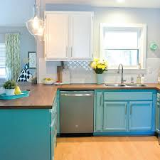 we totally transformed our dated 1980 s kitchen with bright painted cabinets new lighting and