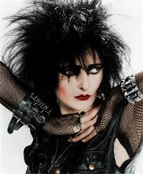 just as siouxsie sioux plays liberally with metaphoric veils in her she does so literally in her se attire as well two defining characteristics