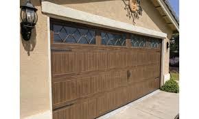liftmaster garage door openers wayne dalton sonoma ranch panel mission oak textured wood grain finish w decorative hardware