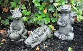 dragon garden sculpture large dragon and gargoyle statues dragon garden statues little darling dragon eating apple