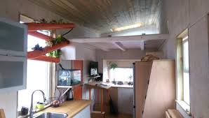 tiny house fridge. Man Builds Tiny House With Rock Climbing Wall Fridge