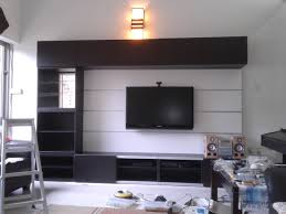 tv design furniture. Black Tv On The White Wall Combined With Wooden Panel Plus Many Shelves, Remarkable Design Furniture F