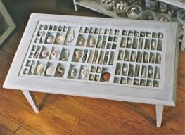 Made From An Upcycled Printeru0027s Drawer, This Coffee Table Lets You Display  Small Trinkets Inside Each Of The Small Compartments Under A Glass Surface.