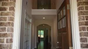 front home entrance lowering door open lowering shot of the front entrance and hallway of