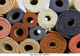 carpet roll. rolls of carpet in a warehouse - stock image roll