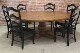 large outdoor round pedestal farmhouse dining table with 6 ladder dining chairs painted with black color and leather seats with high back ideas