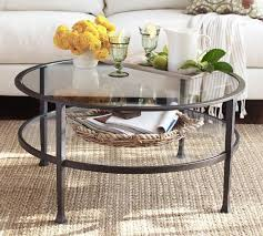 coffee table less volume with the glass but still has some heft with the darker metal tanner era round