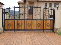 Brick Driveway Idea feat Contemporary Wrought Iron and Wood Combination  Gate Design Plus Lovely Outdoor Lighting
