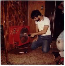 Original Photo: Technician conducts blower door test in early ...