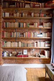amazing idea for home library shelves on the exposed brick wall