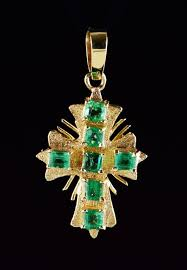 this vintage cross with rays features beautiful emeralds with deep green color saturation all diamonds