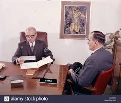 man talking to banker loan officer loans bank desk