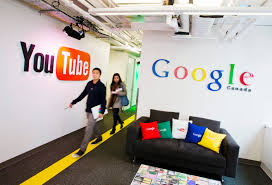 google office youtube. people walk by a youtube sign at the new google office in toronto, nov. youtube