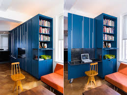 MKCA The office/library inside of the blue multipurpose furniture/storage  cabinet in Unfolding Apartment