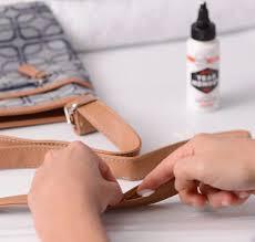 tear mender fixing purse strap