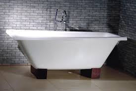furniture white cast iron corner bathtub design with wooden base and exposed stone brick wall
