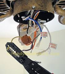 ceiling fan motor. ceiling fan motor capacitor replacement: strip the leads on wires h