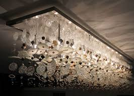 a unique light fixture a work of art made from recycled materials this layered chandelier was installed in a 5 star hotel in cape town
