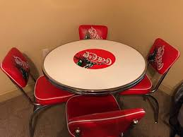 vintage coca cola table and four chairs