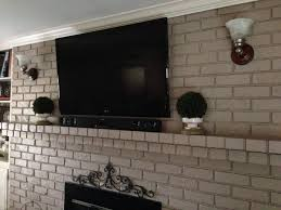 mounting tv brick fireplace hiding wires best for adorable how to rh attane org hide wires on brick wall hide wires on desk