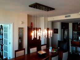 Lighting For Over Dining Room Table Dining Table Chandelier Hovering Just Above A Round Rustic Dining