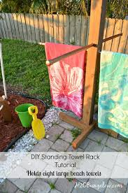 tutorial to make a diy outdoor standing towel rack with 3 options for all building levels