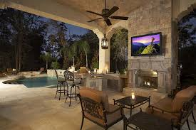 outdoor tv installation on wall above fireplace bwood tn