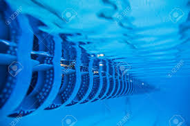 swimming pool lane lines background. Plastic Swimming Pool Floating Wave Breaking Lane Line Detail From Underwater Stock Po 48907020 Lines Background