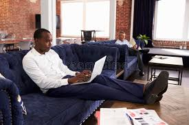 office relaxation. Download Businessmen Working On Sofas In Relaxation Area Of Office Stock Photo - Image Computer