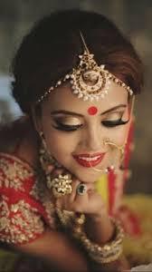 indian bride wearing bridal lehenga and jewelry indianbridalhairstyle indianbridalmakeup indianbridalfashion bridalphotoshoot