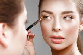 beautiful makes herself a make up in the mirror beauty face photo
