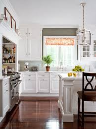 kitchens with white cabinets. Opting For Refined And Simple, This Kitchen Is Outfitted With Classic White Cabinets Countertops Crafted From Honed Statuary Marble Random Gray Kitchens C