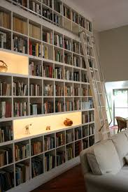 rows of matching billy bookcases from ikea will do the trick if you want to to