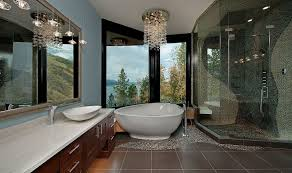 bathrooms contemporary master bathroom with glass chandelier above cornered bathtub and modern vanity cabinet ultra