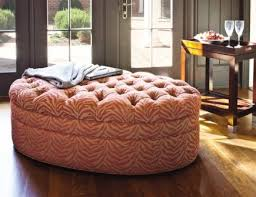 Cocktail ottomans, such as the Marilyn ottoman by Jessica Charles, provide  room for seating or for serving refreshments to those seated at nearby  sofas and ...