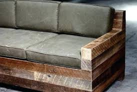 cushions for wooden sofa rustic couch made of four by fours with denim covered cushions and