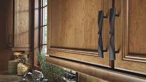 detail of cabinet pulls on delray cherry cabinet doors