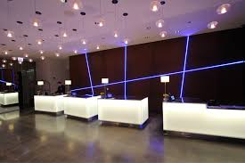 hotel lobby lighting. Intersecting Lines Of ILight Plexineon Blue Series Fixtures Illuminate A Striking Feature Wall Behind The Reception Hotel Lobby Lighting