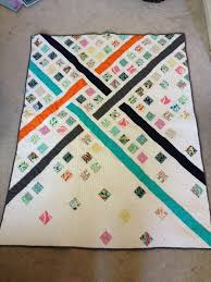 Diagonal Modern Quilt | KrisRunner & I just love empty space that this quilt has to offer. I love the pops of  color. I am learning the I love Modern Quilts over traditional styles. ... Adamdwight.com