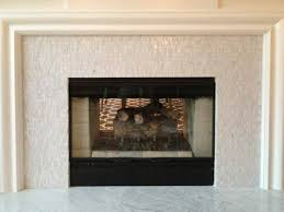 elegant white glass tiled fireplace surround