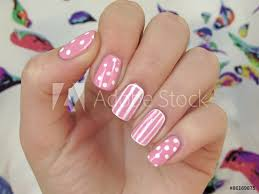 Valokuva Pink Nails With White Dots And White Stripes Tilaa
