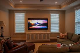 home theater system room. your family room or den is where you spend most of time anyway so why not have us install a discreet entertainment system that has warm, rich sound and home theater