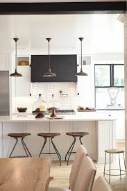 not to be outdone the bonus room features a surprise bar area with durable silestone iconic white countertops this clever multi use e is the