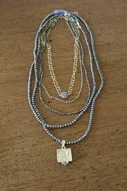 how to layer necklaces styleblueprint com